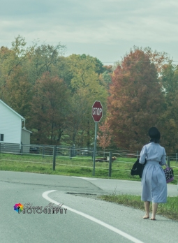 Amish girl walking home from school bare footed